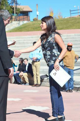 Maysa Semman shakes hands with Dillon town manager Tom Breslin during a citizenship naturalization ceremony at Dillon Amphitheater.