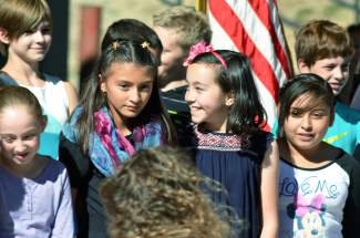 Fifth graders from Dillon Elementary serenade the more than 70 people who became naturalized U.S. citizens on October 8.