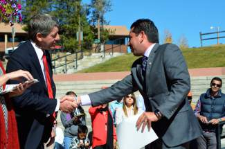 DIllon town manager Tom Breslin congratulates Byron Rojas at a naturalization ceremony on Oct. 8.