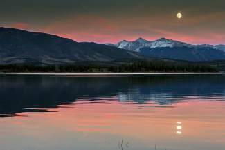 near Full Beaver Moon rising over Colorado 14'ers Grays and Torrey and the Grizzly Ridge portion of the Continental Divide from Frisco, Colorado. www.danielmcvey.com