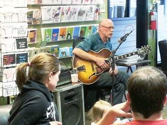 Jobuk Johnson plays at The Next Page Books & Nosh's weekly happy hour on Wednesday, June 18. The next happy hour on Wednesday, June 25, will feature music from Randall McKinnon.