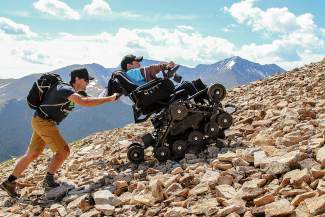 No Barriers co-founder Erik Weihenmayer pushes an Action Track all-terrain chair driven by Cole Rogers, a paraplegic hiker at the No Barriers Summit at Copper Mountain in July. Weihenmayer, the first (and only) blind man to summit Mount Everest, will attend the next No Barriers event in Keystone from July 22-24 with three other participants, including Fort Collins resident Connor Walsh.