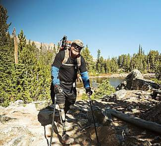 Retired U.S. Air Force mechanic Mark Yearsley on a recent trip in his native Idaho with a hiking leg, one of several attachments he's learned to use after losing his leg to amputation. Yearsley slipped into deep depression after his amputation and credits No Barriers for getting him back outside.
