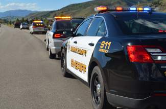 A row of lights from numerous law enforcement vehicles lined State Highway 9 just south of Silverthorne Elementary School early Sunday evening, as emergency responders searched North Pond for a reported drowning victim.