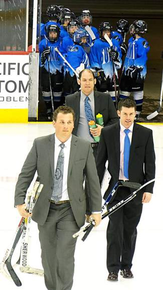 Summit PeeWee coaches (front to back) Taylor Hustead, Wren Arbuthnot and Brad Edelberg lead their team onto the ice at the Pepsi Center before the Colorado Amateur Hockey Association State Championship final on March 12. The Summit team beat Boulder 4-1 for the club's first state title.