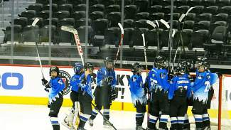 The Summit Youth Hockey PeeWee A Team celebrates on the glass after clinching the club's first state title with a 4-1 win over Boulder at the Pepsi Center on March 13.