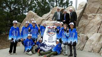 The Summit Youth Hockey PeeWee A team poses for well-deserved photos at Pepsi Center after winning the Colorado Amateur Hockey Association State Championship final on March 13. The team beat Boulder 4-1 for the club's first state title.