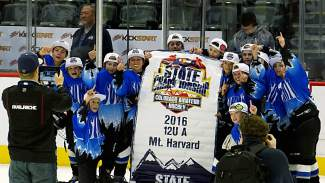 The Summit Youth Hockey PeeWee A team celebrates on the ice at the Pepsi Center after winning the Colorado Amateur Hockey Association state title on March 13. It's the first state title for the club.