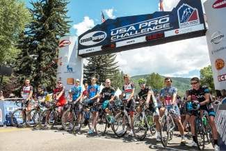 The riders lined up for introductions prior to the start of Stage 1 of the 2013 USA Pro Challenge In Aspen