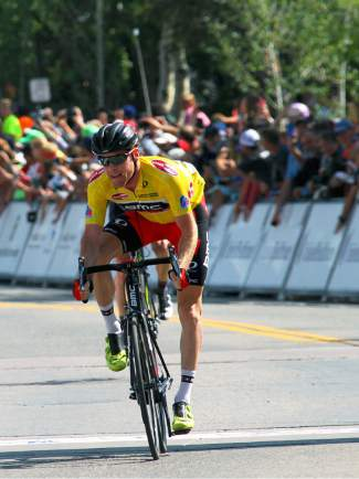 Brent Bookwalter with BMC Racing passes the finish line ahead of Robbie Squire of Hincapie Racing to take second at Stage 4 of the USA Pro Challenge on Main Street Breckenridge.