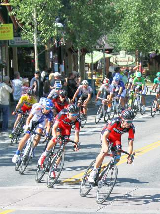 The front of the peloton approaches Wellington Street in Breckenridge before pedaling up the final hill climb of USA Pro Challenge Stage 4 at Moonstone Road, led by Dennis Rohan and Brent Bookwalter of BMC Racing.