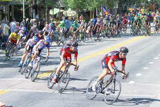 Dennis Rohan and Brent Bookwalter of BMC Racing lead the pack through a tight turn on Wellington Road in Breckenridge during Stage 4 of the USA Pro Challenge on Aug. 20.