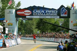 Stage 4 winner Rohan Dennis of BMC Racing celebrates his first win of the 2015 USA Pro Challenge in front of thousands of fans on Main Street Breckenridge Aug. 20.