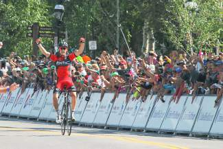 Stage 4 winner Rohan Dennis of BMC Racing starts celebrating long before crossing the finish line alone on Main Street Breckenridge for his first win of the 2015 USA Pro Challenge.