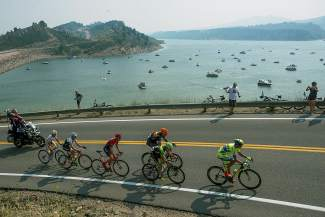 The lead pelaton of the mens USA Pro Challenge race from Loveland to Fort Collins passes by Horsetooth Reservoir Saturday, August 22, 2015.
