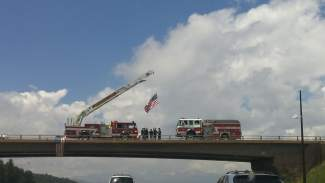 Flags were hung across bridges and the Eisenhower-Johnson Memorial Tunnel as the procession passed through, in honor of Patrick Mahany.
