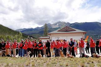 Summit County Search and Rescue staff and trained avalanche dogs lined up outside Summit Medical Center in Frisco.