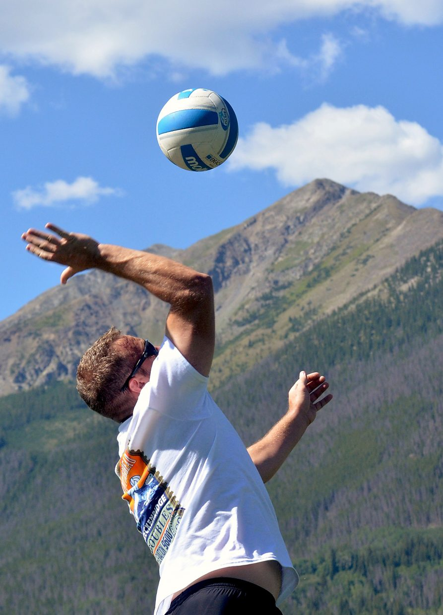 A players serves on the grass courts in Frisco with Peak One in the background during the annual Putterhead Doubles volleyball tournament on Aug. 13. Now in its 26th season, the tournament drew more than 600 teams from across the state for two days of sand and grass volleyball in Breck, Frisco and Silverthorne.