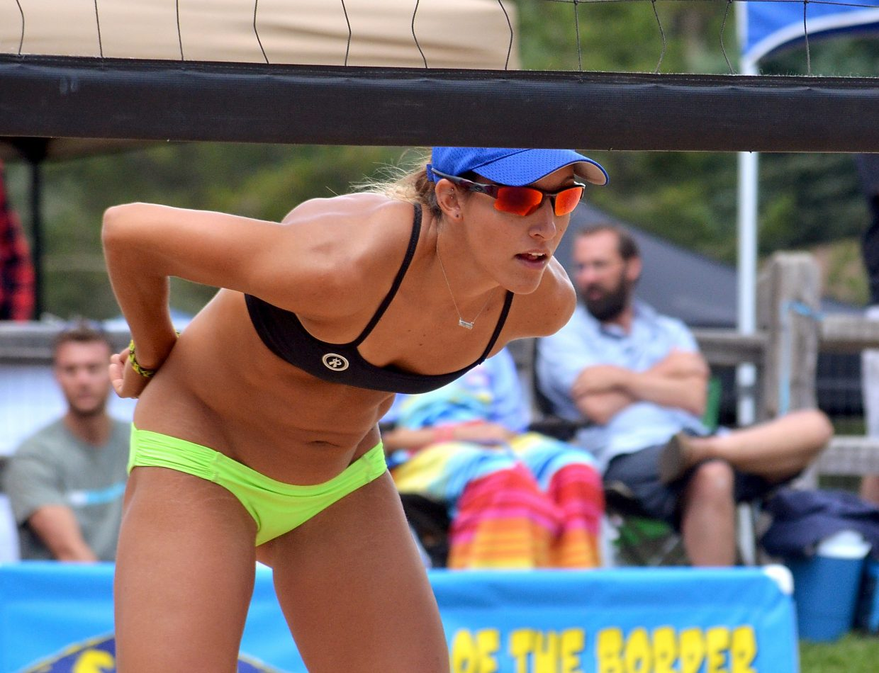 AVP pro and Colorado native Emily Stockman waits for teammate Kris Bredehoft to serve on the sand courts at Carter Park in Breckenridge during the annual Putterhead Doubles volleyball tournament on Aug. 13.