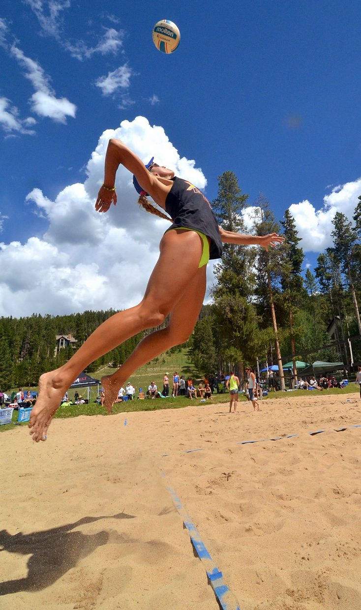 AVP pro Emily Stockman serves on the sand courts at Carter Park in Breckenridge during the annual Putterhead Doubles volleyball tournament on Aug. 13. Now in its 26th season, the tournament drew more than 600 teams from across the state for two days of sand and grass volleyball in Breck, Frisco and Silverthorne.