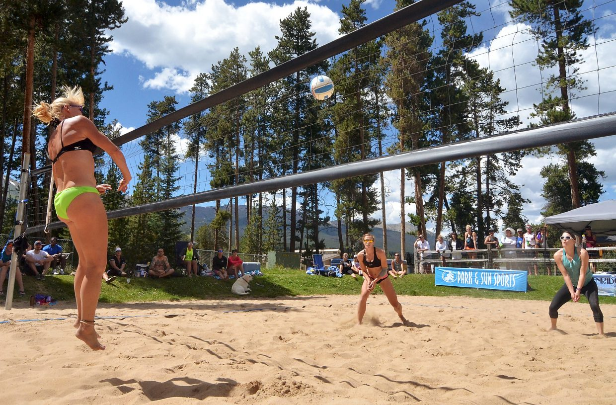 Denver-based pro Kris Bredehoft (left) unleashes a massive hit to Denver's Katie Vatterrodt (middle) and Krystin Rodrick (right) on the sand courts at Carter Park in Breckenridge during the annual Putterhead Doubles volleyball tournament on Aug. 13.
