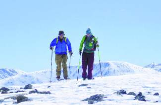 Fritz Sperry (left) and Teague Holmes crest over a false summit at Quandary Peak (14,265 feet), one of three Summit County 14ers with Grays and Torreys Peaks to the east. The two are backcountry veterans with decades of combined experience skiing Colorado peaks.