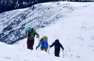 A group of trekkers led by Teague Holmes (front) makes the final push along the East Ridge to the summit of Quandary Peak (14,265 feet). The trip is relatively short at less than 3 miles one way, but the established route still covers 3,400-plus vertical feet through wooded glades and over windblown snow.