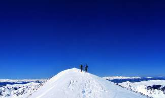 Backcountry gurus Teague Holmes (left) and Fritz Sperry travel the final few feet from the false summit to true summit at Quandary Peak (14,265 feet) in early May.