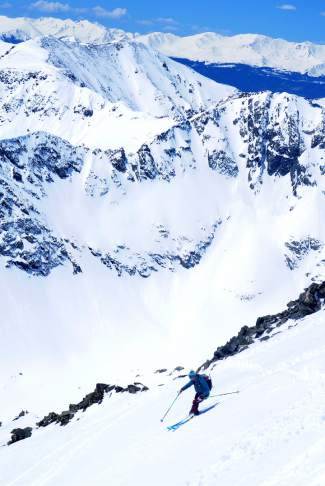 Teague Holmes of Blue River skis past rocks in the upper half of the Cristo Couloir, a popular route from the summit of Quandary Peak (14,265 feet). The mountain is home to three additional lines, ranging from 20 degrees on the East Slopes to nearly 50 degrees in the North Couloir and North Gullies.