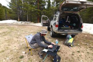 The author at his mobile office at the base of James Peak in the Arapahoe National Forest, found near St. Mary's Glacier between Winter Park and Idaho Springs.