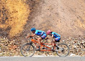 A team on a tandem mountain bike rides through the mine tailings of French Creek during the 2016 Breck 100 mountain bike race. More than 350 mountain bikers from across the state and nation came for a full day of riding on three local loops in three divisions: a 32-mile lap on the Colorado Trail, a 68-mile race on the CT and Boreas Pass to Como, and the full 100-mile race on both loops with an early-morning loop on Wheeler Pass. Too bad these two are blurry.