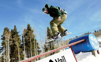 Bob Aubrey jibs a rail during the Ravinos St. Patrick's Day reunion ski day at Golden Peak in Vail in 2010.