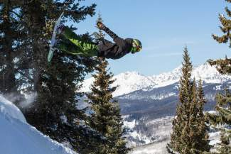 Summit County resident Ian Smith performs a lawn dart front flip on Vail Mountain in honor of deceased snowboarder Ben Hinkley. Hinkley was one of the first professional African American snowboarders and is best remembered for the lawn dart and double lawn dart, which he performed at multiple X Games and World Cups during the '90s.