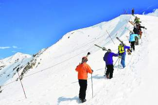 A group of skiers earn their turns by hiking up a section of the Continental Divide known as