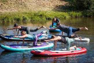 Intructor Leslie Ross teaches a SUP yoga class at the Breckenridge Recreation Center.