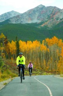 In this file photo, Dave and Kathy O'Sadnick roll past a stand of changing aspens on the Frisco Recreation Path with Peak One and Tenmile Peak in the background.