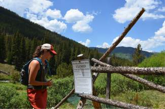 Emily Orbanek, Great Outdoors Colorado's (GOCO) liaison to Colorado Parks and Wildlife, observes signage at a fen restoration area along Summit County's proposed Fremont Recpath on Monday, June 20.