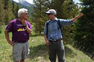 Jason Lederer, resource specialist for Summit County Open Space & Trails, points out a feature along the county's proposed Fremont Recpath to Great Outdoors Colorado (GOCO) executive director Jim Spaanstra on Monday, June 20.