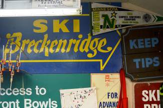 A spattering of signs on the wall at Pup Ascher's ski shop in Breckenridge. The large