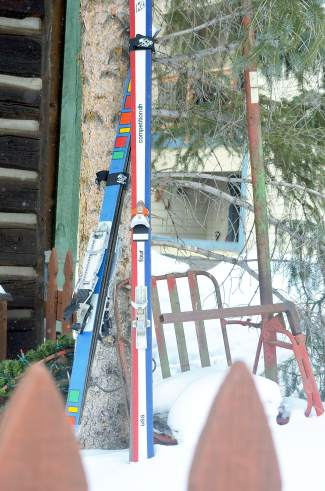 In his front yard, Pup Ascher keeps two circa-1970 skis and an original single-person chair from Aspen Mountain's first chairlift. The ski on the right is a K2 Four belonging to CJ Mueller, another longtime Breckenridge local. The ski on the right is known as only The Ski, and it's outfitted with a vintage pair of Rammer alpine touring bindings.