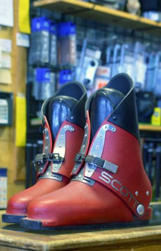 A pair of '70s-era Scott boots at Precision Ski and Golf in Frisco. Owner Jimbo Deines remembers skiers walking around with different colored boots (one white, one yellow, one orange, one red) because the boots are made of fiberglass and had a tendency to literally explode with hard impacts.