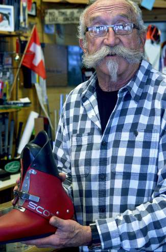 Longtime Summit local Jimbo Deines with a pair of '70s-era Scott boots. Deines has owned Precision Ski and Golf in Frisco for nearly 35 years and has gear dating back at least that long.
