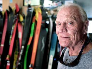 Jim Bowden in his garage with a collection of vintage Head race skis. Most of the ski belonged to Max Dercum, one of the founders of Arapahoe Basin and Keystone Resort. Dercum gave Bowden about 50 pairs in 1985 when his wife needed garage space.