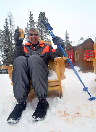Steve Immer lounging in his '80s-era Descente onesie behind the Breckenridge Nordic Center on a spring powder day. Earlier that morning, the 73-year-old Immer charged powder on one of his favorite runs, Ptarmigan, using a ski technique he learned struggling with