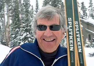 Breckenridge resident Steve Immer with a pair of '60s-era Norwegian-made cross-country skis similar to the pair he donated several years ago. Where is the pair currently housed? In the men's bathroom at the Breckenridge Nordic Center.