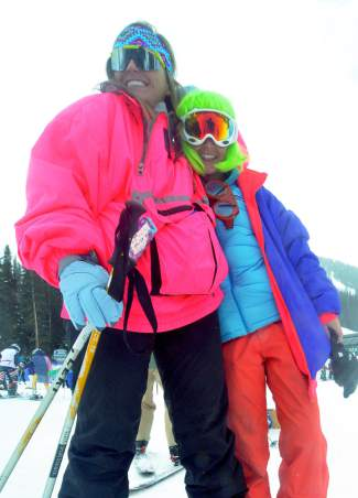 Neon peas in a pod: Friends Isabelle Thompson (left) and Caroline Lambert ditched class at University of Denver on April 1 for Gaper Day at Arapahoe Basin. The two paired retro jackets with yoga tights, headbands and Pit Vipers. You'd think there was a hot tub time machine around there somewhere.