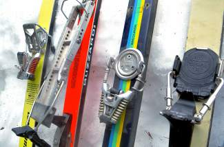 Several decades worth of bindings technology on Peter Dunn's vintage ski collection. From left to right: Marker M4-15 on Volkl Renn Tigers from 1979; Ramer Alpine Touring bindings, built in Boulder in the '80s; another pair of M4-15 Marker bindings on Hexcel Super Comps from 1976; and Look Pivot bindings made in France.