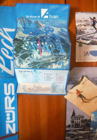 A collection of old ski photos and ski trail maps in Peter Dunn's kitchen, including an Arapahoe Basin map from the final season before the Pallavicini Chair was installed.
