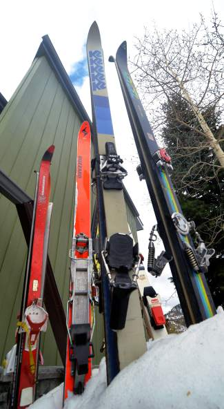 A smattering of Peter Dunn's vintage skis in his Frisco front yard. He's collected nearly a dozen over the years, including Hexcel Super Comps from 1976 and Volkl Renn Tigers from 1979.