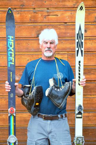 Peter Dunn near his backyard shop in Frisco with two pairs of vintage skis: Hexcel Super Comps from 1976 (left) and Volkl Renn Tigers (1979). Both come equipped with Marker M4-15 bindings, aka Marker